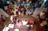 INDIA (West Bengal - Calcutta)  2006, A dance program staged at Mullick family (one of the well known families in South Calcutta) on the occassion of Durga Puja Festival. Durga Puja Festival is the biggest festival among bengalies.  As Calcutta is the capital of West Bengal and cultural hub of  the bengali community Durga puja is held with the maximum pomp and vigour. Ritualistic worship, food, drink, new clothes, visiting friends and relatives places and merryment is a part of it. In this festival the hindus worship a ten handed godess riding on a lion armed wth all possible deadly ancient weapons along with her 4 children (Ganesha - God for sucess, Saraswati - Goddess for arts and education, Laxmi - Goddess of wealth and prosperity, Kartikeya - The god of manly hood and beauty). Durga is symbolised as the women power in Indian Mythology.  In Calcutta people from all the religions enjoy these four days of festival in the moth of October. Now the religious festival has become the biggest cultural extravagenza of Calcutta the cultural capital of India. Artistry and craftsmanship can be seen in different sizes and shapes in form of the idol, the interior decor and as well as the pandals erected on the streets, roads and  parks.- Arindam Mukherjee