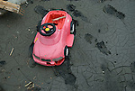 A child's toy car lies in the mud after the tsunami that followed the March 11 magnitude 9 quake in Ishinomaki, Miyagi Prefecture on 15 March, 2011. Photographer: Robert Gilhooly
