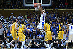 29 December 2014: Duke's Jahlil Okafor dunks the ball. The Duke University Blue Devils hosted the University of Toledo Rockets at Cameron Indoor Stadium in Durham, North Carolina in a 2014-16 NCAA Men's Basketball Division I game. Duke won the game 86-69.