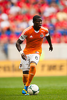 Kofi Sarkodie (8) of the Houston Dynamo. The New York Red Bulls defeated the Houston Dynamo 2-0 during a Major League Soccer (MLS) match at Red Bull Arena in Harrison, NJ, on June 30, 2013.