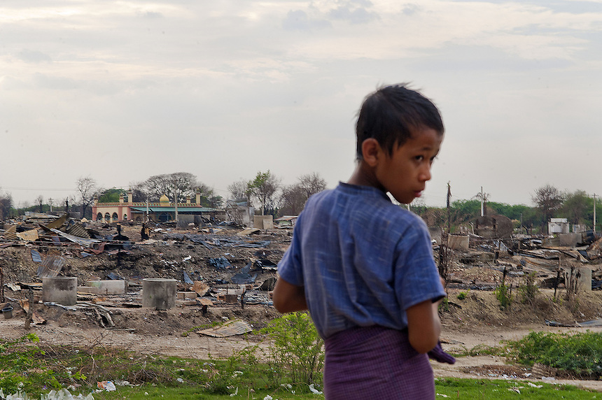 A displaced Buddhist boy takes refuge at a Buddhist monastery near Chan Aye quarter where 761 houses were burned by Buddhist mobs. Most were Muslim, but some were also Buddhist owned.<br /> The neighborhood was burned by Buddhist mobs following a quarrel between a Muslim gold shop owner and a Buddhist woman on March 20. Buddhists allege that later that day Muslims dragged a monk off a motorbike and tried to light him on fire in front of a mosque. Muslims claim the monk caught on fire when he was torching the mosque. More than 40 people were killed from the violence that resulted in hundreds of homes being destroyed over a course of a week- mainly Muslim - across 11 townships in Mandalay Division and Pegu Division. <br /> The attacks on Muslim neighborhoods by Buddhist have coincided with the emergence of the 969 movement. The movement encourages Buddhists to shop at Buddhist owned shops with stickers to identify them. The most vocal advocate of the 969 movement is the Buddhist monk Ashin Wirathu. Wirathu's sermons border on paranoia, purporting that Muslim men are trying to convert the country to Islam by marrying Buddhist women. Wirathu was in Meikhtila when the violence erupted and was also there one month earlier to deliver a 3 day sermon.