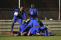 Lapton celebrate their second goal - Lapton (blue/black) vs Bancroft United (yellow/white) - Hackney & Leyton League Dickie Davies Cup Final at Waltham Forest FC - 29/04/11 - MANDATORY CREDIT: Gavin Ellis/TGSPHOTO - Self billing applies where appropriate - Tel: 0845 094 6026