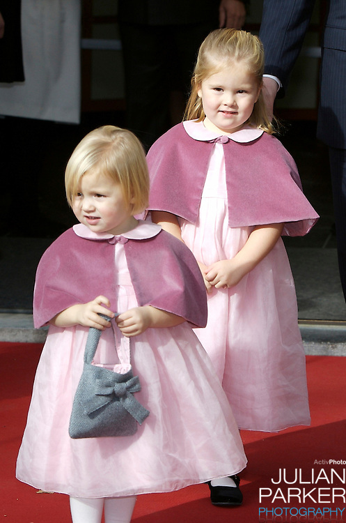 Princess Catharina Amalia and Princess Alexia of The Netherlands attend their sister Princess Ariane of The Netherlands Christening at The Kloosterkerk in The Hauge, Holland.