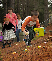 NWA Democrat-Gazette/BEN GOFF @NWABENGOFF<br /> Graham Sellers, 5, of Bella Vista and other pre-K and kindergarten age children hunt eggs on Saturday March 12, 2016 during the annual Easter egg hunt at First United Methodist Church of Bella Vista.