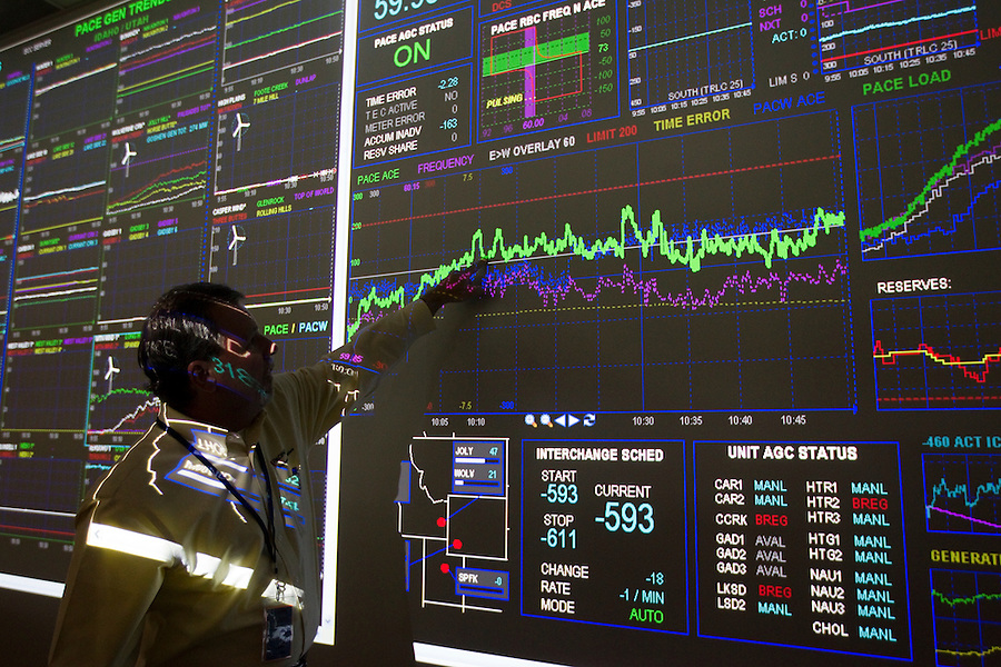 Mark Sampson, Vice President of System Operations at PacifiCorp interprets data from a graph at a Transmissions Grid Operation center in east Portland, Or. May 27, 2014. PacifiCorp is one of the lowest-cost electricity producers in the United States, providing 1.8 million customers with energy. PacifiCorp has more than 10,500 megawatts of generation capacity from coal, hydro, renewable wind power, gas-fired combustion turbines, solar and geothermal. (Photo by Natalie Behring/ Bloomberg News)