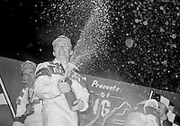 Derek Daly celebrates iwith champagne after winning the 12 Hours of Sebring, Sebring Raceway, Sebring, FL, March 16, 1991.  (Photo by Brian Cleary/www.bcpix.com)