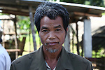 "A villager poses for a portrait in A Luoi, Vietnam. Most villagers in the area are members of ethnic minority hill tribes formerly known as Montangards. The man was a beneficiary of the ""Orange Cow"" program, sponsored by the Australia-based Vietnamese Victims of Agent Orange Trust,  which raises money to purchase breeding cows for families who have been affected by Agent Orange exposure. April 25, 2013."