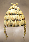Boar's tusk helmet with cheek guards and double bone hook on top. Tomb 515 Mycenae, Greece. 14th-15th century BC. National Archaeological Museum, Athens.. The Boar's tusk helmet was described in the Iliad as follows &quot;Meriones gave Odysseus a bow, a quiver and a sword, and put a cleverly made leather helmet on his head. On the inside there was a strong lining on interwoven straps, onto which a felt cap had been sewn in. The outside was cleverly adorned all around with rows of white tusks from a shiny-toothed boar, the tusks running in alternate directions in each row..?Homer, Iliad 10.260-5&quot;