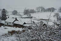 Farm in a snow covered landscape.