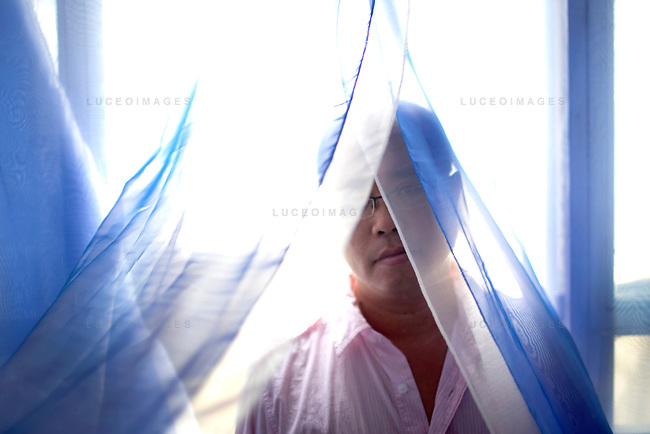 Dinh Q. Le is a Vietnamese American fine arts photographer best known for his woven-photographs. Le uses traditional weaving techniques to combine mournful images from the Vietnam War with a sort of colorful fantasy. Le now works from his home in Ho Chi Minh City, Vietnam.