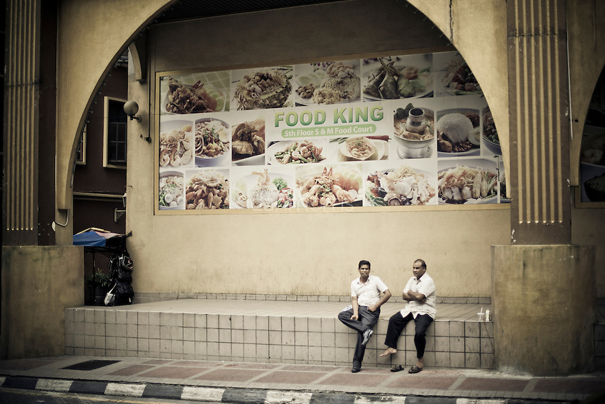 Men take a break in downtown Kuala Lumpur