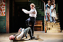 London, UK. 22.05.2015. THE BEAUX' STRATAGEM, by George Farquhar, directed by Simon Godwin, opens in the Olivier, at the National Theatre. Lighting design by Jon Clark, set and costume design by Lizzie Clachan, movement by Jonathan Goddard. Picture shows: Mark Rose (Hounslow), Samuel Barnett (Aimwell), Susannah Fielding (Mrs Sullen), Pippa Bennett-Warner (Dorinda). Photograph © Jane Hobson.