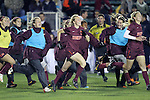 08 November 2013: Virginia Tech's Kelsey Loupee (9) and other Virginia Tech players race onto the field to celebrate the victory. The University of Virginia Cavaliers played the Virginia Tech Hokies at WakeMed Stadium in Cary, North Carolina in a 2013 NCAA Division I Women's Soccer match and the semifinals of the Atlantic Coast Conference tournament. Virginia Tech won the game 4-2.