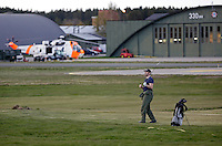 Systems operator H&aring;vard Bakke enjoying a game of golf. Crew from Norwegian Air Force 330 squadron, flying Westland Sea King helicopter. The core mission of the squadron is SAR (search and rescue), but they also fly HEMS (Helicopter Emergency Medical Service), complementing the civilian air ambulance service.<br />