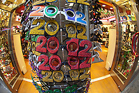 A souvenir store in midtown in New York sells 2012 glasses to celebrate New Years on Thursday, November 24, 2011.  (© Frances M. Roberts)
