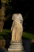 Low angle view of the remains of a Roman female statue in the garden of the National Archaeological Museum. Carthage, Tunisia, pictured on January 2, 2008, in the late afternoon. Carthage was founded in 814 BC by the Phoenicians who fought three Punic Wars against the Romans over this immensely important Mediterranean harbour. The Romans finally conquered the city in 146 BC. Subsequently it was conquered by the Vandals and the Byzantine Empire. Today it is a UNESCO World Heritage. The National Archaeological Museum (Musee National de Carthage) houses an impressive collection of Punic and Christian relics found in the excavations, including stelae, jewellery, sarcophagi and reliefs. It also features maps, photographs and models of the ancient city. Picture by Manuel Cohen.