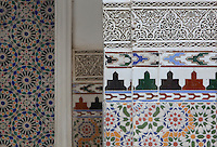 Zellige tile decoration on the walls of the ground floor of the central courtyard area, in a typical Tetouan riad, a traditional muslim house built around a courtyard, built in Moorish style with strong Andalusian influences, next to the Great Mosque or Jamaa el Kebir in the Medina or old town of Tetouan, on the slopes of Jbel Dersa in the Rif mountains of Northern Morocco. Tetouan was of particular importance in the Islamic period from the 8th century, when it served as the main point of contact between Morocco and Andalusia. After the Reconquest, the town was rebuilt by Andalusian refugees who had been expelled by the Spanish. The medina of Tetouan dates to the 16th century and was declared a UNESCO World Heritage Site in 1997. Picture by Manuel Cohen