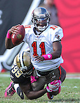 Tampa Bay Buccaneers quarterback Josh Johnson (11) is brought down by New Orleans Saints defensive lineman Jimmy Wilkerson (99) in the fourth quarter. The Saints defeated the Buccaneers 31-6 in Tampa, Fla, Sunday, October 17, 2010. (AP Photo/Margaret Bowles)