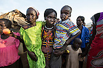 Mcc0075406 . Daily Telegraph<br /> <br /> DT Foreign<br /> <br /> <br /> 25 yr old mother Nyabura Nyon is reunited with her children after three years Nyathor aged 6 and Sebit aged 4 .<br /> <br /> POC 3 , the Protection of Civilian Camp inside the vast UN compound on the outskirts of Juba . Over 20,000 civilians who predominantly fled from conflict in the equatorial states of South Sudan . United Nation's agencies recently announced a famine in the war torn country .<br /> <br /> Juba 27 February 2017