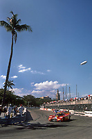 MIAMI, FL - FEBRUARY 24: With a Goodyear blimp overhead, the Alba/Momo AR5 Ford of Gianpiero Moretti and Massimo Sigala is driven into the hairpin corner during the Löwenbräu Grand Prix of Miami IMSA GTP/Lights race on the temporary street circuit in Bicentennial Park in Miami, Florida, on February 24, 1985.
