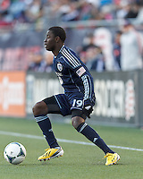 Sporting Kansas City substitute midfielder Peterson Joseph (19)looks to pass.  In a Major League Soccer (MLS) match, Sporting Kansas City (blue) tied the New England Revolution (white), 0-0, at Gillette Stadium on March 23, 2013.