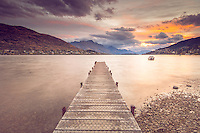 A beautiful suset at the Frankton Jetty  looking across Lake Wakatipu towards Cecil and Walter Peaks, Queenstown, New Zealand