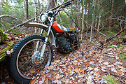 Abandoned Yamaha 250 motorcycle near the Mt Cilley Trail in Woodstock, New Hampshire USA.