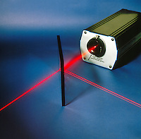 TRANSMISSION &amp; REFLECTION of GAS LASER BEAM (2 of 2)<br /> By Glass Plate At Angle Other Than 90'<br /> Beam of Helium neon laser passing through glass at angle other than 90'is reflected. The presence of two reflected beams is due to reflection off the front and back surfaces of the glass plate.