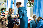 Girls attend a sewing class at a local school on Sunday, October 20, 2013 in Baikalsk, Russia.