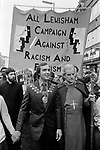The Bishop of Southwark, Mervyn Stockwood, and the Mayor of Lewisham Roger Godsiff (Mayor 1977-8), London.1977<br /> Police protect members of the National Front, during the so-called Battle of Lewisham, which took place on 13 August. 500 members of the National Front marched from New Cross to Lewisham, various counter-demonstrations by approximately 4,000 people led to violent clashes between the two groups and between the anti-NF demonstrators and police. 5,000 police officers were present and 56 officers were injured in the riots, 11 of whom were hospitalised. 214 people were arrested for obstructing the police, threatening behaviour, assault, possession of an offensive weapon and throwing missiles. Later disturbances in Lewisham town centre saw the first use of police riot shields on the UK mainland.