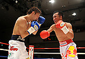 (L-R) Akira Yaegashi (JPN), Pornsawan Porpramook (THA), OCTOBER 24, 2011 - Boxing : Pornsawan Porpramook of Thailand in action against Akira Yaegashi of Japan during the fifth round of the WBA minimumweight title bout at Korakuen Hall in Tokyo, Japan. (Photo by Mikio Nakai/AFLO)