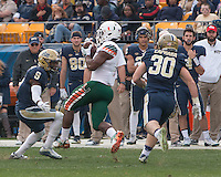 Miami running back Mark Walton makes a catch while Pitt defenders Jordan Whitehead (9) and Mike Caprara (30) look on. The Miami Hurricanes football team defeated the Pitt Panthers 29-24 on  Friday, November 27, 2015 at Heinz Field, Pittsburgh, Pennsylvania.