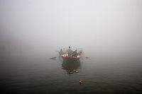 Pilgrims at Varanasi's ghats after bathing in the sacred Ganges river. The ghats attract millions of Hindu pilgrims from across India every year. ..Photo: Tom Pietrasik.Varanasi, India.March 5th 2008..THIS PHOTOGRAPH IS THE COPYRIGHT OF TOM PIETRASIK. THE PHOTOGRAPH MAY NOT BE REPRODUCED IN ANY FORM OTHER THAN THAT FOR WHICH PERMISSION WAS GRANTED. THE PHOTOGRAPH MAY NOT BE STORED OR MANIPULATED WITHOUT PRIOR PERMISSION FROM TOM PIETRASIK...Tom Pietrasik.PHOTOGRAPHER.India tel: +91 9810614419.UK tel: +44 7710507916.Email: tom@tompietrasik.com.Website: tompietrasik.com..Photo: Tom Pietrasik.Gurgaon, India.February 27th 2008..THIS PHOTOGRAPH IS THE COPYRIGHT OF TOM PIETRASIK. THE PHOTOGRAPH MAY NOT BE REPRODUCED IN ANY FORM OTHER THAN THAT FOR WHICH PERMISSION WAS GRANTED. THE PHOTOGRAPH MAY NOT BE STORED OR MANIPULATED WITHOUT PRIOR PERMISSION FROM TOM PIETRASIK...Tom Pietrasik.PHOTOGRAPHER.India tel: +91 9810614419.UK tel: +44 7710507916.Email: tom@tompietrasik.com.Website: tompietrasik.com