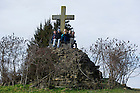 January 15, 2012; Students gather on the base of a large cross during free quiet time at Gethsemani. The University of Notre Dame Folk Choir held a concert for the Monastic and local community during their 2012 retreat at The Abbey of Gethsemani, Trappist, Kentucky. Photo by Barbara Johnston/University of Notre Dame