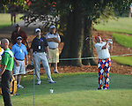 Golfer John Daly swings on the first hole at the PGA FedEx St. Jude Classic at TPC Southwind in Memphis, Tenn. on Thursday, June 9, 2011.
