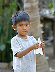 A boy folds a paper airplane in Zipolite, a town in Oaxaca, Mexico.