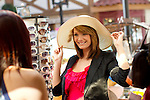 Female shoppng and trying on hats
