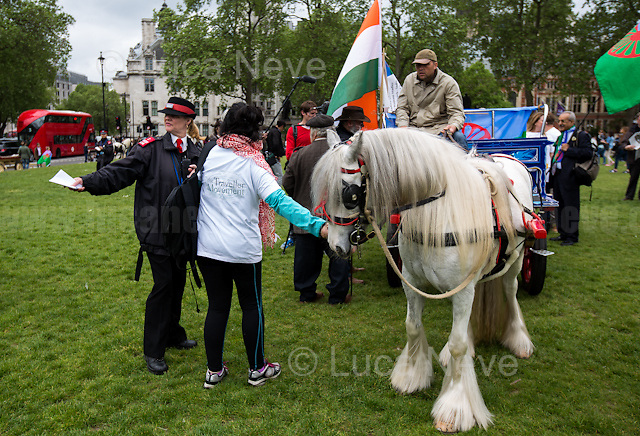 London, 21/05/2016. Today, Travellers, Gypsies and Roma held a demonstration outside the Houses of Parliament against the British Conservative Government alleged plan to abolish Traveller sites weakening the rights of Gypsies, the Roma Community and Parvees (Irish Travellers). From the 38 Degrees online petition ( http://bit.ly/1ORgP9x ): &lt;&lt;[&hellip;] According to the new incarnation of 'gypsy status' that was passed into planning law last year, we will only be classed as Romany Gypsies and Irish, Scottish, English and other Travellers if we 'travel' for work purposes. This has been done by the government to allow councils to artificially reduce the number of Gypsies and Travellers in their area at the stroke of a bureaucrat's pen. There is no cultural or ethnic dimension to 'gypsy status'. Similar to the common racist refrain more often found on online comment threads about us &ndash; according to this government, if we don't 'travel' then we can't possibly be Gypsies and Travellers. Already councils are sending out researchers who are trying to get us to fill in forms with detailed and intrusive questions about our 'travelling' habits. If we don&rsquo;t have 'gypsy status' we may no longer develop and build a Gypsy and Traveller site and we may even lose our place on an existing public or private legal Traveller site. The result will be that many Gypsies and Travellers will be forced back onto the road because they will be made homeless, or to 'prove' their ethnic identity and heritage to retain their homes. [&hellip;] We see this as a direct attack on our culture and heritage and on our children's futures and their right to define who they are in their own terms. We see it as a racist attack in that it seeks to marginalise us and deny us a rightful and legitimate place in this society. [&hellip;]&gt;&gt;.<br /> <br /> For more information please click here: http://bit.ly/1U6pswi &amp; http://lgtu.org.uk/