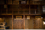 """Photo shows the """"gakuya"""" dressing room area of Korakukan theater, Japan's oldest extant wooden playhouse in Kosaka, Akita Prefecture Japan on 19 Dec. 2012. Made entirely from wood, the theater was opened in 1910 and was registered as an Important Cultural Property in 2007. On the walls is the graffiti -- written by actors -- for which the theater is also famed. Photographer: Robert Gilhooly"""