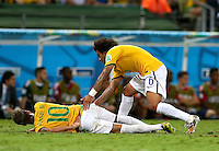 Neymar of Brazil goes down with an injury to his back before having to be stretchered off
