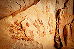 Ancestral Puebloan (Anasazi) pictographs of hands on the sandstone ceiling of an alcove near Bluff in southern Utah.