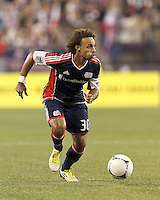New England Revolution defender Kevin Alston (30) on the attack. In a Major League Soccer (MLS) match, Montreal Impact defeated the New England Revolution, 1-0, at Gillette Stadium on August 12, 2012.