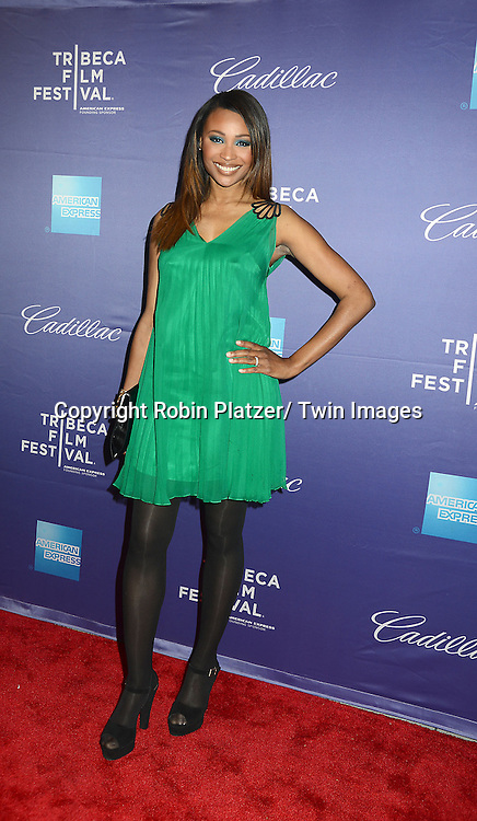 """Cynthia Bailey in Phoebe Couture green dress attends the Tribeca Film Festival World Premiere of """" In God We Trust"""" on April 19, 2013 at the SVA Theatre in New York City. The movie is about Eleanor Squallari who was the former secretary of Bernie Madoff."""
