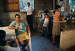 HONDURAS-10022, Honduras, 2004. A family relaxes in their home.