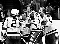 California Golden Seals celebrate goal against the Flyers. Marshall Johnston, Wayne Carleton, and Stan Gilbertson, and Bobby Sheehan. (1971 photo/Ron Riesterer)