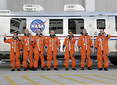 Cape Canaveral, FL - March 15, 2009 - The STS-119 crew members pause for photos before boarding the Astrovan to take them to Launch Pad 39A at NASA's Kennedy Space Center in Florida for launch of space shuttle Discovery to the International Space Station. From left are Mission Specialists Koichi Wakata, John Phillips, Richard Arnold, Steve Swanson and Joseph Acaba, Pilot Tony Antonelli and Commander Lee Archambault. Wakata represents the Japan Aerospace Exploration Agency and will remain on the International Space Station, replacing Expedition 18 Flight Engineer Sandra Magnus, who returns to Earth with the STS-119 crew. Liftoff of Discovery is scheduled for 7:43 p.m. EDT on March 15. An earlier launch attempt March 11 was scrubbed at 2:36 p.m. due to a gaseous hydrogen leak from the external tank at the Ground Umbilical Carrier Plate during tanking. A seven-inch quick disconnect and two seals were replaced. The STS-119 mission is the 28th to the space station and the 125th space shuttle flight. Discovery will deliver the final pair of power-generating solar array wings and the S6 truss segment. Installation of S6 will signal the station's readiness to house a six-member crew for conducting increased science. Photo credit: NASA/Kim Shiflett.Credit: NASA via CNP