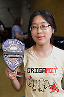 Michelle Fung, California, USA holds her MIT Police badge design