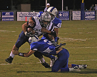 Local High School football action. Two Lampasas Badgers are bringing down an opponent on their home field. Poster Edge Effect.
