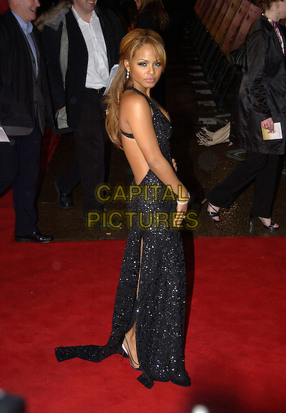"CHRISTINA MILIAN.""Be Cool"" UK film premiere.Empire cinema, Leicester Square.London 7 March 2005.Ref:PL.full length black dress sequined looking over shoulder.www.capitalpictures.com.sales@capitalpictures.com.©Capital Pictures."