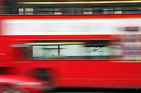 Red car, red London Bus passing through the TEA building, Shoreditch, London, UK. Picture by Manuel Cohen